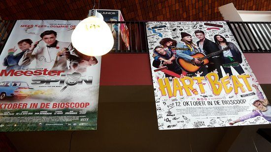 pathe delft movie posters hanging from the second floor